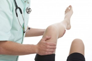 Doctor treating osteoarthritis patient's symptoms