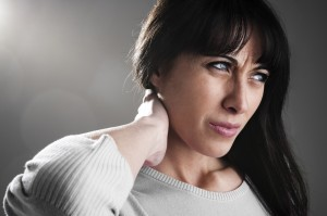 Woman suffering from fibromyalgia pain in the neck