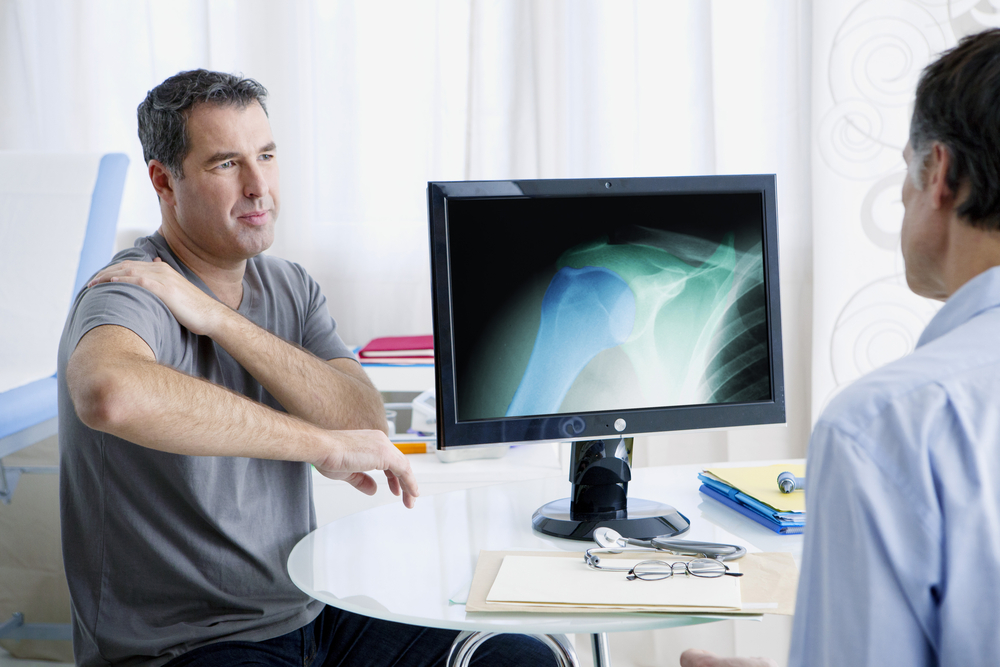 Rheumatologist meets with male patient