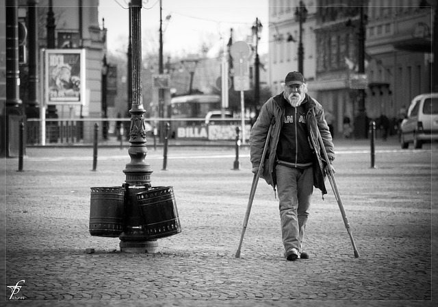 Arthritic man using crutches not to fall