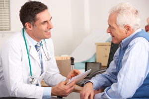 Doctor discusses prostate cancer clinical trials with older man