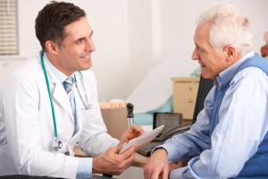 Doctor discussing arthritis complications with older patient
