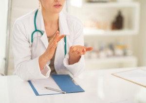 Oncologist discussing colonoscopy benefits with patient
