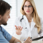 Man discusses prostate cancer tests with his urologist