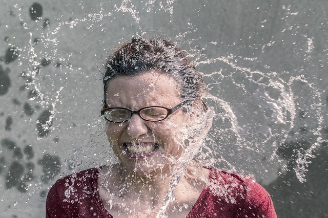 Woman splashed with ice water to raise awareness for ALS